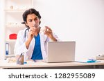 young male doctor with human's...   Shutterstock . vector #1282955089