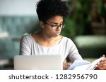 concentrated mixed race woman... | Shutterstock . vector #1282956790