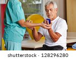 senior man with spikey balls in ... | Shutterstock . vector #128296280