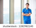 young handsome doctor working...   Shutterstock . vector #1282982140