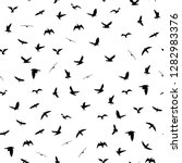flying birds silhouettes on... | Shutterstock .eps vector #1282983376
