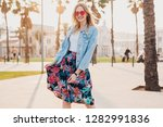 pretty smiling woman walking in ... | Shutterstock . vector #1282991836
