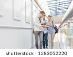 students exchanging books while ... | Shutterstock . vector #1283052220