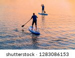 people standing up on paddle... | Shutterstock . vector #1283086153
