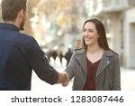 happy man and woman handshaking ... | Shutterstock . vector #1283087446