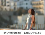 relaxed woman in a town... | Shutterstock . vector #1283094169