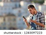 amazed man checking smart phone ... | Shutterstock . vector #1283097223