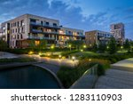 green park with modern houses... | Shutterstock . vector #1283110903