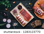 smoked sausage on a wooden...   Shutterstock . vector #1283123770