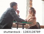close up. loving couple sitting ... | Shutterstock . vector #1283128789