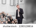 speaker conducts the business... | Shutterstock . vector #1283128816