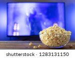 a glass bowl of popcorn and... | Shutterstock . vector #1283131150