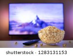 a glass bowl of popcorn and... | Shutterstock . vector #1283131153