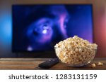 a glass bowl of popcorn and... | Shutterstock . vector #1283131159