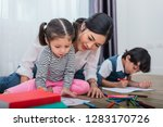 mother teaching children in... | Shutterstock . vector #1283170726
