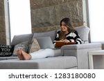 beautiful young woman relaxing... | Shutterstock . vector #1283180080