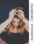 blonde woman is worried. she... | Shutterstock . vector #1283180743