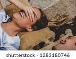 young smiling couple lying on... | Shutterstock . vector #1283180746