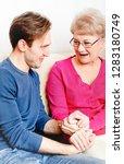 grandson visits grandmother in... | Shutterstock . vector #1283180749