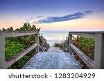 boardwalk leading down to the...   Shutterstock . vector #1283204929