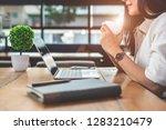 asian working woman using... | Shutterstock . vector #1283210479
