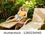 girl talking on the phone on... | Shutterstock . vector #1283236960