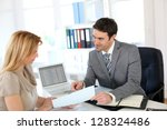woman meeting banker to set up... | Shutterstock . vector #128324486