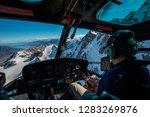 Helicopter High Above Glacier