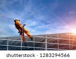 safety sprinkling worker on... | Shutterstock . vector #1283294566