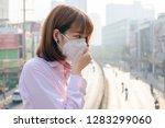 asian woman wearing the n95... | Shutterstock . vector #1283299060