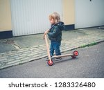 a little toddler is in the road ... | Shutterstock . vector #1283326480