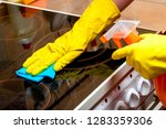 housewife cleans glass ceramic... | Shutterstock . vector #1283359306