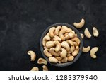 cashew nuts in bowl on black... | Shutterstock . vector #1283379940