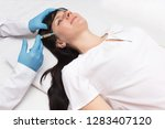 a doctor makes a plasma lifting ... | Shutterstock . vector #1283407120