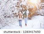 young family for a walk. mom...   Shutterstock . vector #1283417650
