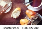 bun with butter to a cup of...   Shutterstock . vector #1283422900