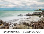 sea side rocks  long exposure... | Shutterstock . vector #1283470720
