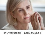 close up face grey haired woman ... | Shutterstock . vector #1283501656