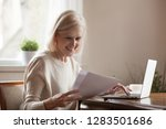 happy blond positive aged woman ... | Shutterstock . vector #1283501686