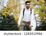 indian man riding bicycle to... | Shutterstock . vector #1283513986