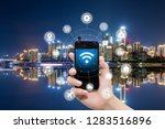 smart phone in hand and using... | Shutterstock . vector #1283516896