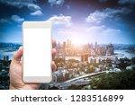 business man hand holding white ... | Shutterstock . vector #1283516899