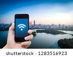 smart phone in hand and using... | Shutterstock . vector #1283516923