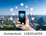 smart phone in hand and using... | Shutterstock . vector #1283516950