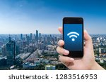 smart phone in hand and using... | Shutterstock . vector #1283516953
