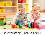 preschool boy and girl playing... | Shutterstock . vector #1283517013