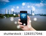 smart phone in hand and using... | Shutterstock . vector #1283517046