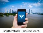 smart phone in hand and using... | Shutterstock . vector #1283517076