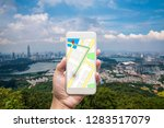 mobile gps navigation on mobile ... | Shutterstock . vector #1283517079