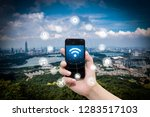 smart phone in hand and using... | Shutterstock . vector #1283517103